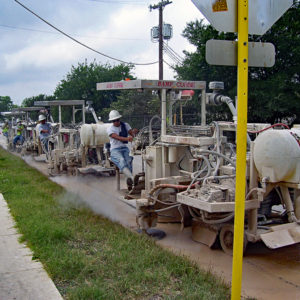 The team at Texas Curb Cut joining forces with 4 Curb Cutting Machines to cut an entire block of Concrete Curbs.