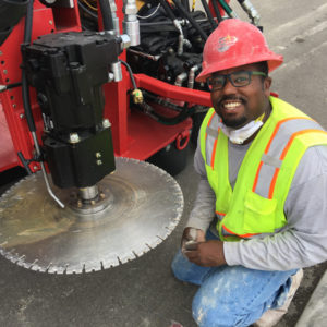 "Texas Curb Cut employee installing a 24"" Diamond Saw Blade prior to beginning  his day."